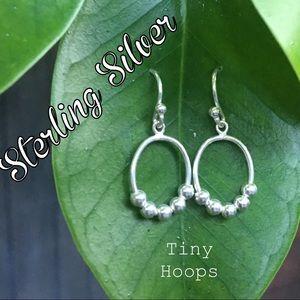 Little silver dangling earrings